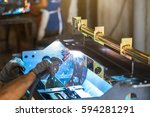 worker welding the sheet metal... | Shutterstock . vector #594281291