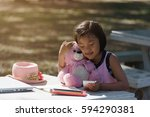 little girl playing with a pink ... | Shutterstock . vector #594290381