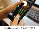 trading online on smartphone... | Shutterstock . vector #594315911