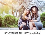 portrait of two beautiful young ... | Shutterstock . vector #594322169