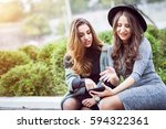 portrait of two beautiful young ... | Shutterstock . vector #594322361