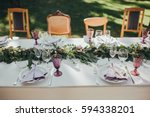 festive table served dishes and ... | Shutterstock . vector #594338201