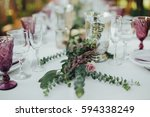 festive table served dishes and ... | Shutterstock . vector #594338249