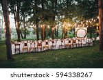 festive table served dishes and ... | Shutterstock . vector #594338267
