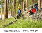 group of cyclists on a halt....   Shutterstock . vector #594379619