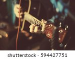 a guy playing an acoustic... | Shutterstock . vector #594427751
