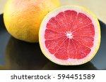 fresh red grapefruit on the... | Shutterstock . vector #594451589