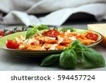 ravioli with tomato sauce and...   Shutterstock . vector #594457724