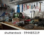 messy workshop  complete chaos... | Shutterstock . vector #594485219