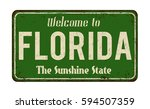 welcome to florida vintage... | Shutterstock .eps vector #594507359