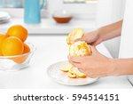 female hands peeling orange ... | Shutterstock . vector #594514151
