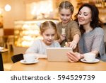 twin girls and her mother... | Shutterstock . vector #594529739