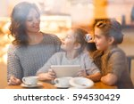 woman and her daughters... | Shutterstock . vector #594530429