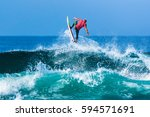 riding the waves. costa rica ... | Shutterstock . vector #594571691