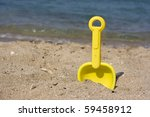 Plastic Toy Shovel In The Sand