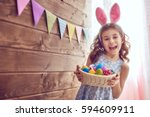 Stock photo cute little child wearing bunny ears on easter day girl holding basket with painted eggs 594609911