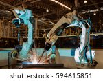 industrial robots are welding... | Shutterstock . vector #594615851