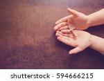 wooden cross on praying... | Shutterstock . vector #594666215