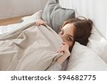 female lying covered with... | Shutterstock . vector #594682775
