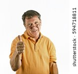 Small photo of smart man in studio shows gesture all right