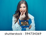 happy woman eating chocolate... | Shutterstock . vector #594734369