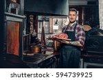 handsome bearded cook holds...   Shutterstock . vector #594739925