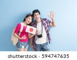 young couple take japan flag... | Shutterstock . vector #594747635