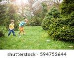 kids on easter egg hunt in... | Shutterstock . vector #594753644
