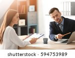 hr manager interviewing young... | Shutterstock . vector #594753989