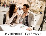 loving couple drinking coffee... | Shutterstock . vector #594774989