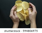 pile of potato chips and women... | Shutterstock . vector #594806975