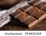 milk and dark chocolate on a... | Shutterstock . vector #594831569