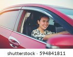 young woman happy in car | Shutterstock . vector #594841811