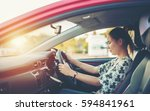 young woman happy in car | Shutterstock . vector #594841961