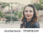 happy beautiful woman walking... | Shutterstock . vector #594858104