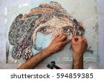 man making mosaic | Shutterstock . vector #594859385
