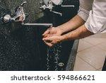 muslim man washing his hands | Shutterstock . vector #594866621