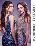 portrait of two elegant young... | Shutterstock . vector #594872867