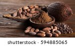 cocoa pod on wooden background | Shutterstock . vector #594885065