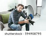Photographer Working In His...