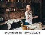 a girl in the kitchen sprinkles ... | Shutterstock . vector #594926375