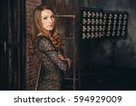 girl in the grunge studio  with ... | Shutterstock . vector #594929009