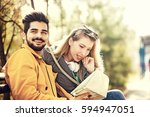 young couple is enjoying spring ... | Shutterstock . vector #594947051