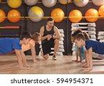 children at physical education... | Shutterstock . vector #594954371