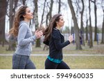 two young woman is running in a ... | Shutterstock . vector #594960035