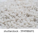 Small photo of white PET chips, master batch, polymer resin in laboratory, thermal storage master batch, plastic granulate for injection molding process