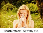 girl with alergy blowing her... | Shutterstock . vector #594989411