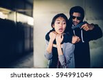 man in hoodie robbing and... | Shutterstock . vector #594991049