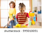 child girl and mother make... | Shutterstock . vector #595010051