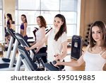 young women running on... | Shutterstock . vector #595019885